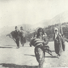 An Armenian woman is forced to march in the desert carrying her child